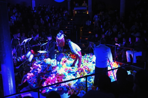 The Roots performing live among some balloon animals.  Photo by Mel D. Cole taken with respect from Okayplayer.